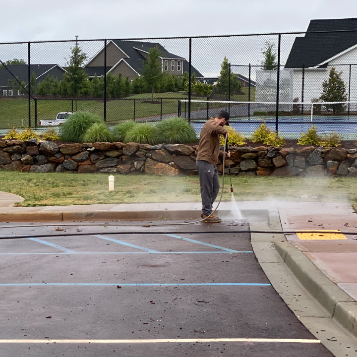 cleaning the concrete at a new community center